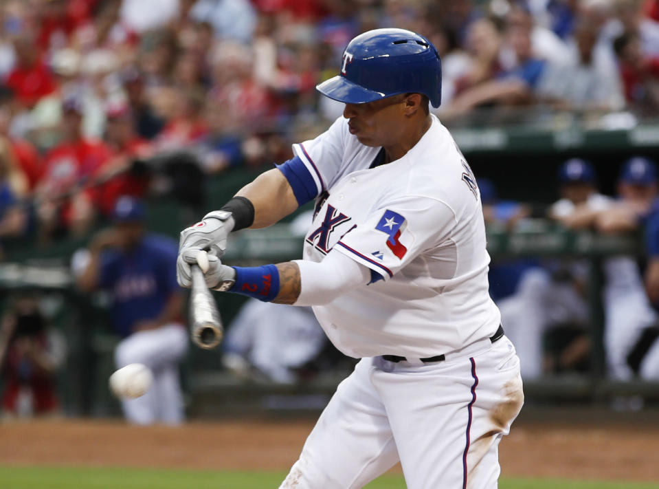 Texas Rangers' Leonys Martin connects for an infield single against the Los Angeles Angels during the third inning of a baseball game, Wednesday, July 31, 2013, in Arlington, Texas. (AP Photo/Jim Cowsert)
