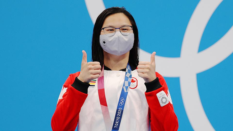 TOKYO, JAPAN - JULY 26: Margaret Macneil of Team Canada poses with the gold medal for the Women's 100m Butterfly Final on day three of the Tokyo 2020 Olympic Games at Tokyo Aquatics Centre on July 26, 2021 in Tokyo, Japan. (Photo by Maddie Meyer/Getty Images)