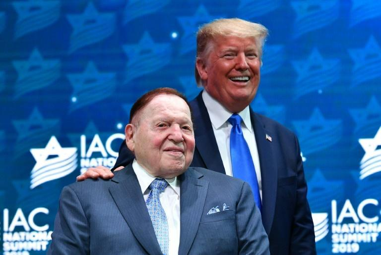 US President Donald Trump stands on stage with mogul Sheldon Adelson at a Florida event in 2019