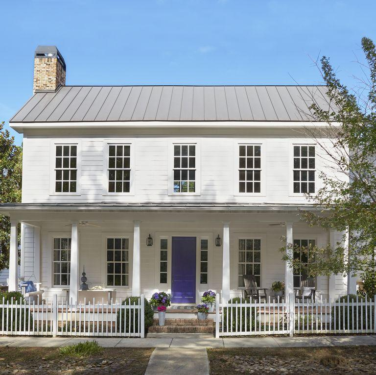 """<p>Create a seriously fun front porch by adding a purple door that will look beautiful surrounded by vibrant flower pots.</p><p><a class=""""link rapid-noclick-resp"""" href=""""https://go.redirectingat.com?id=74968X1596630&url=https%3A%2F%2Fwww.homedepot.com%2Fp%2FBEHR-PREMIUM-PLUS-1-gal-PPU16-03-Purple-Paradise-Semi-Gloss-Enamel-Low-Odor-Interior-Paint-and-Primer-in-One-330001%2F300399581&sref=https%3A%2F%2Fwww.countryliving.com%2Fhome-design%2Fcolor%2Fg31158913%2Ffront-door-colors%2F"""" rel=""""nofollow noopener"""" target=""""_blank"""" data-ylk=""""slk:SHOP PURPLE PAINT"""">SHOP PURPLE PAINT</a></p>"""