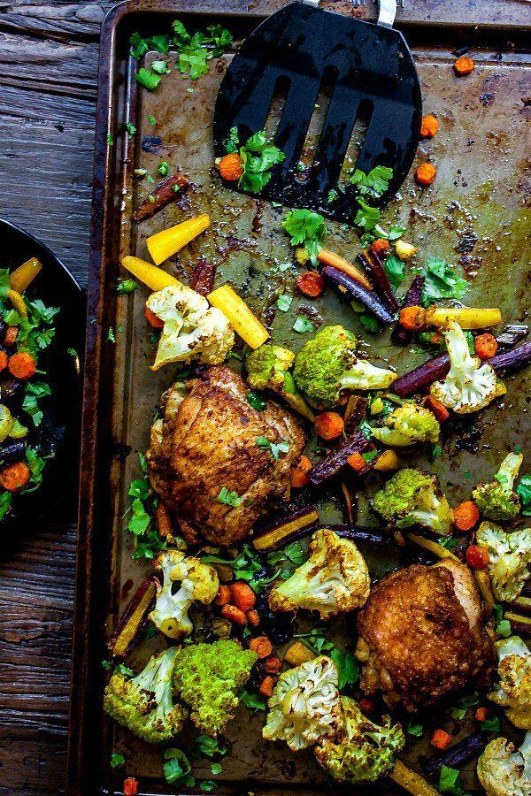 """<p>This recipe by<a href=""""https://www.homemadeinterest.com/sheet-pan-curried-chicken-and-vegetables/"""" rel=""""nofollow noopener"""" target=""""_blank"""" data-ylk=""""slk:Home Made Interest"""" class=""""link rapid-noclick-resp""""> Home Made Interest</a> is super easy to make and you'll save tons of time with clean up, as it only requires one pan. The crispy chicken thighs and curry flavors give you that indulgent feel, but the whole meal is under 400 calories. Plus, it'll be ready in 40 minutes and can work well as leftovers for the week.</p>"""