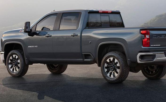 <p>At the rear, similarities to the 1500 are more pronounced, but the tailgate is less chiseled, and the bed itself is boxier. According to Chevy, the HDs have a taller seating position and three additional inches of legroom compared to the 1500.</p>