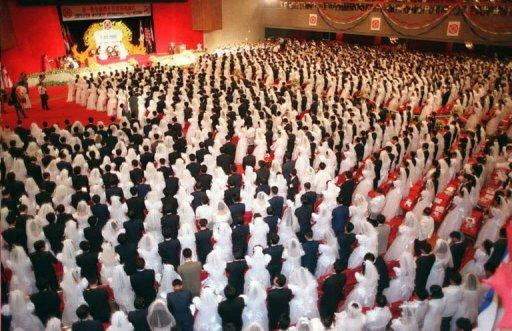 More than 1,000 Korean and Filipino couples attend a mass wedding ceremony performed by the founder of the Unification Church Sun Myung Moon. The Unification Church s widely known for conducting mass weddings among followers involving thousands of couples. It says it evangelises in some 200 countries and according to another spokesman has some three million followers worldwide