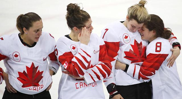 Lauriane Rougeau, and Rebecca Johnston look on as Laura Stacey consoles Laura Fortino. (Steve Russell/Toronto Star via Getty Images)