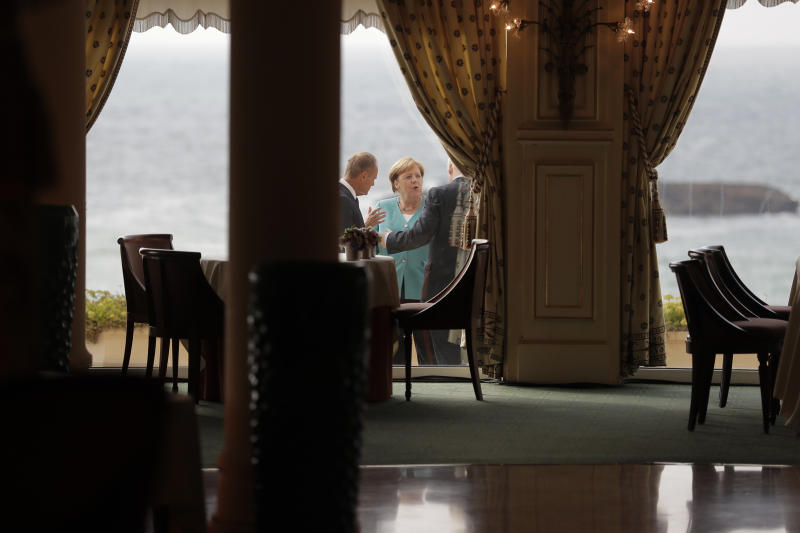 German Chancellor Angela Merkel, center, talks to President of the European Council Donald Tusk, left, and British Prime Minister Boris Johnson during a G7 coordination meeting with the Group of Seven European members at the Hotel du Palais in Biarritz, southwestern France, Saturday, Aug. 24, 2019. Efforts to salvage consensus among the G-7 rich democracies frayed Saturday in the face of U.S. President Donald Trump's unpredictable America-first approach even before the official start of the summit in southern France. (AP Photo/Markus Schreiber, Pool)