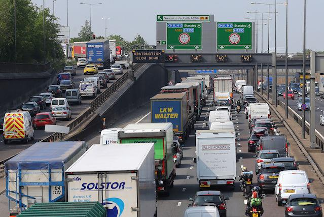 File photo dated 27/05/16 of traffic queues, as traffic jams on the UK's major roads could reach a peak next month, new figures show.