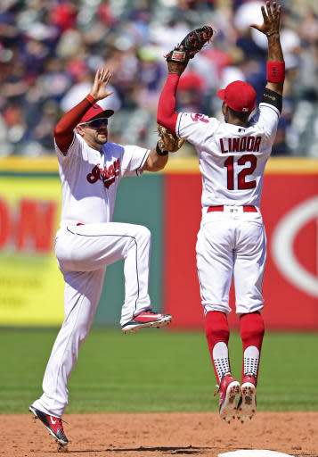 Cleveland Indians' Francisco Lindor, right, and Lonnie Chisenhall celebrate after defeating the Detroit Tigers 12-2 in a baseball game, Sunday, June 24, 2018, in Cleveland. (AP Photo/David Dermer)
