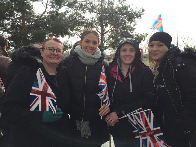 Lydia, Karen, Lucy and Becky, representatives from homeless charity Forgotten Feet, braved the rain to spot Harry and Meghan