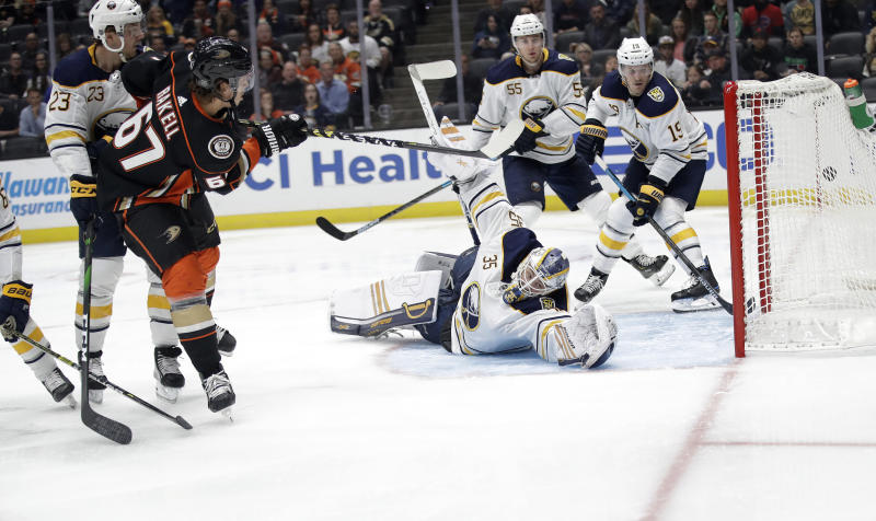 Anaheim Ducks' Rickard Rakell (67) scores past Buffalo Sabres goaltender Linus Ullmark, bottom center, during the second period of an NHL hockey game Wednesday, Oct. 16, 2019, in Anaheim, Calif. (AP Photo/Marcio Jose Sanchez)