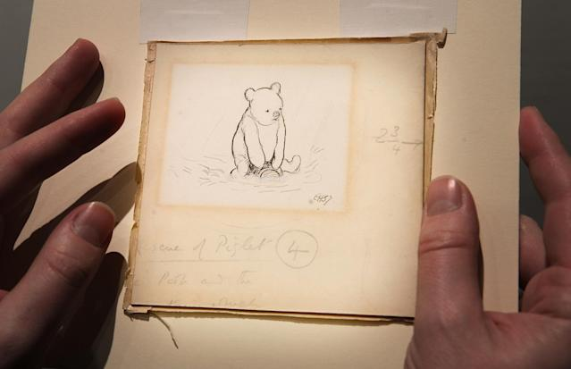 """Early drawings by Pooh co-creator E.H. Shepard depict the bear with no clothes at all, as shown in this sketch from the 1920s titled """"Floating Bear."""" (Photo: Getty Images)."""