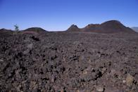 """<p><strong>Craters of the Moon National Monument & Preserve</strong></p><p><a href=""""https://www.nps.gov/crmo/index.htm"""" rel=""""nofollow noopener"""" target=""""_blank"""" data-ylk=""""slk:Craters of the Moon National Monument & Preserve"""" class=""""link rapid-noclick-resp"""">Craters of the Moon National Monument & Preserve</a> in Snake River Plain in central Idaho. It's unlike any National Park encompassing three major lava fields. Get your moon shoes because you can see some of the best examples of rift cracks in the world—including the deepest known on earth at 800 feet.</p>"""
