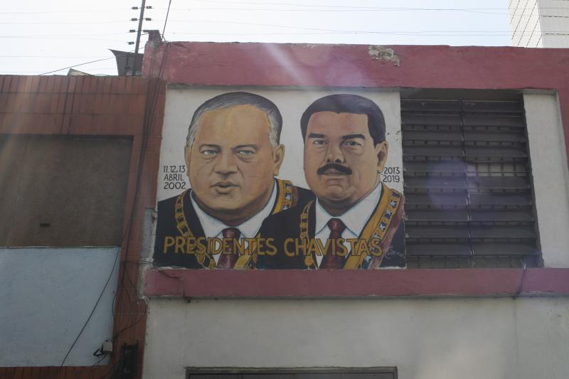 "CARACAS, VENEZUELA - MARCH 26: A painting of the leaders of the Bolivarian Revolution Diosdado Cabello and President Nicolas Maduro with the phrase ""Presidents of Venezuela"" hangs on a house's window on March 26, 2020 in Caracas, Venezuela. Attorney General William Barr announced charges against Venezuelan President Nicolas Maduro on drug crimes and offered a 15 million dollar reward for information leading to the his capture. (Photo by Leonardo Fernandez Viloria/Getty Images)"