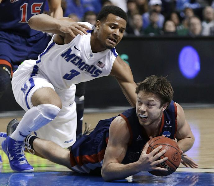 Saint Mary's guard Matthew Dellavedova, right, dives for the ball as Memphis guard Chris Crawford defends in the second half of a second-round game of the NCAA college basketball tournament in Auburn Hills, Mich., Thursday, March 21, 2013. Memphis won 54-52. (AP Photo/Paul Sancya)