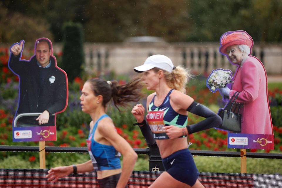 <p>Athletes ran past cardboard cut-outs during the race, including those of Prince William and Queen Elizabeth II</p>