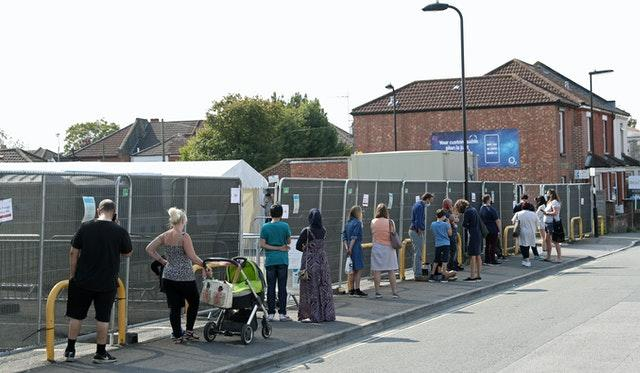 People queue outside a walk-in coronavirus testing centre in Marlborough Road in Southampton (Andrew Matthews/PA)