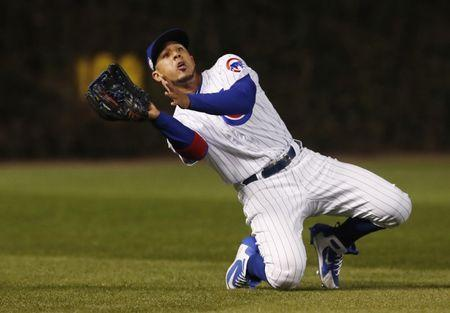FILE PHOTO: Oct 18, 2017; Chicago, IL, USA; Chicago Cubs left fielder Jon Jay makes a catch on a ball hit by Los Angeles Dodgers first baseman Cody Bellinger (not pictured) in the seventh inning in game four of the 2017 NLCS playoff baseball series at Wrigley Field.