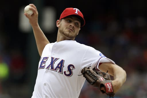 Texas Rangers starting pitcher Justin Grimm delivers to the Houston Astros in the first inning of a baseball game on Sunday, July 7, 2013, in Arlington, Texas. (AP Photo/Tony Gutierrez)