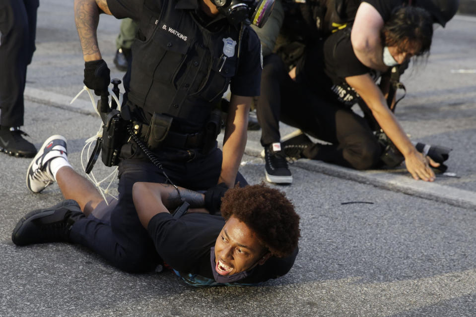 Demonstrators are detained by Atlanta Police during a protest, Saturday, May 30, 2020 in Atlanta. (AP Photo/Brynn Anderson)