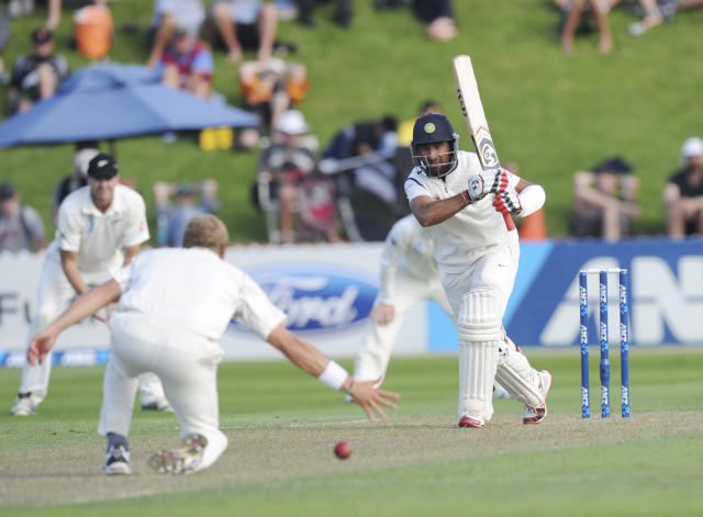 India's Cheteshwar Pujara bats the ball pats New Zealand's Neil Wagner on the first day of the second cricket test in Wellington, New Zealand, Friday, Feb. 14, 2014. (AP Photo/SNPA, Ross Setford) NEW ZEALAND OUT