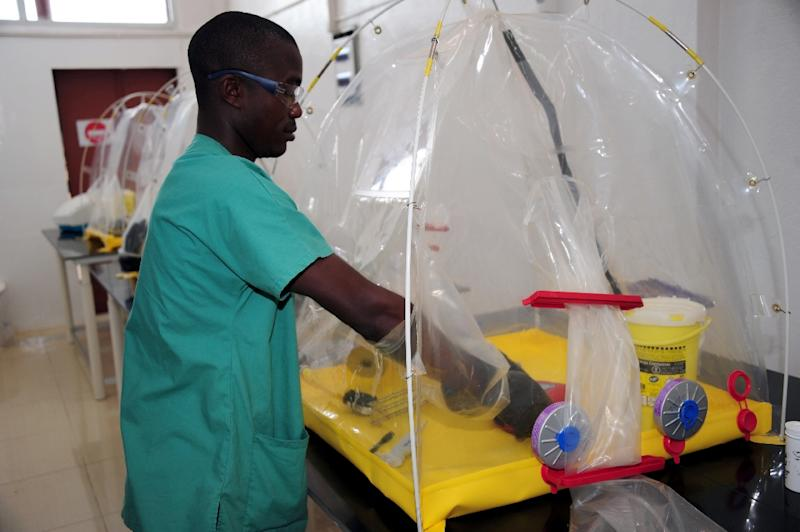 A nurse works on April 7, 2015 in Liberia's first ever a children's hospital, just opened in Monrovia by Medecins sans Frontieres (MSF) as part of the country's response to the daunting challenge of repairing its wrecked health service (AFP Photo/Zoom Dosso)