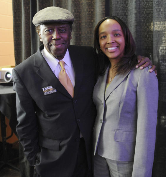 FILE - In this April 17, 2011 file photo, Gary, Ind., mayoral candidate Ragen Hatcher poses for a photo with her father, former Gary Mayor Richard Hatcher, prior to a election forum held in downtown Gary. On Friday, Dec. 13, 2019, Hatcher, who became one of the first black mayors of a big U.S. city when he was elected in 1967, died. He was 86. (AP Photo/Joe Raymond)