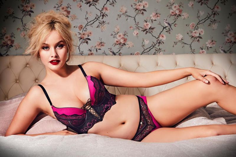 In a bolder fluorescent pink lingerie number, the star shows off her alluring side posing up a storm on a bed. Source: Bras N Things