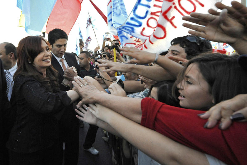 In this picture released by Argentina's Press Office, President Cristina Fernandez, left, greets supporters during the inauguration of an energy plant in San Juan Argentina, Thursday April 19, 2012. Argentina's government showed no signs of backing down Thursday from expropriating a Spanish company's controlling stake in YPF, Argentina's formerly state-owned energy company, shrugging off international condemnation while finding overwhelming support for the plan in congress. (AP Photo/Argentina's Press Office)
