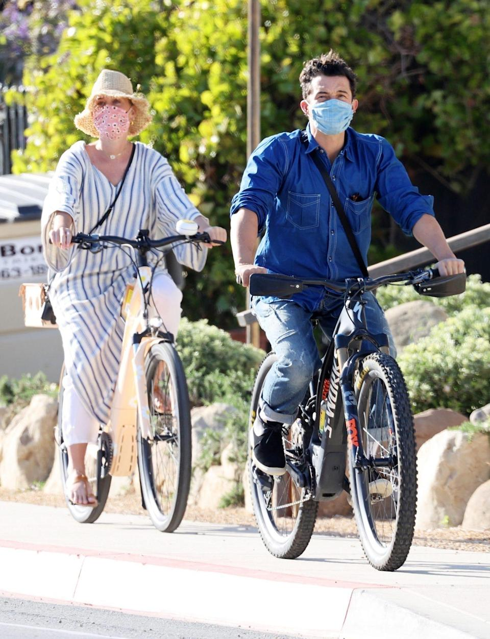 <p>Katy Perry and Orlando Bloom enjoy an afternoon bike ride together on Thursday in Santa Barbara. </p>