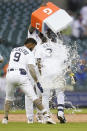 Detroit Tigers' Harold Castro is doused with water by Niko Goodrum after his game winning single against the Chicago Cubs in the 10th inning of a baseball game in Detroit, Saturday, May 15, 2021. Detroit won 9-8. (AP Photo/Paul Sancya)