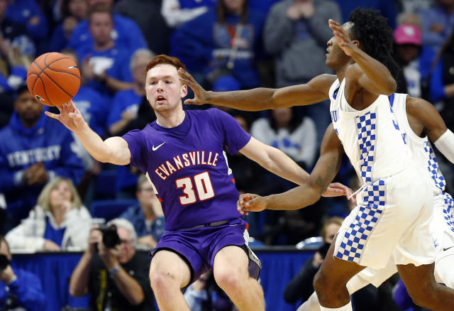 Evansville's Noah Frederking (30) passes the ball away from the defense of Kentucky's Immanuel Quickley during the second half of an NCAA college basketball game in Lexington, Ky., Tuesday, Nov. 12, 2019. Evansville won 67-64. (AP Photo/James Crisp)