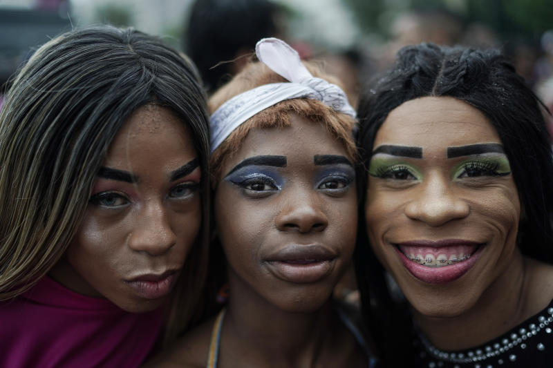 "Revelers pose for a picture during the annual gay pride parade along Copacabana beach in Rio de Janeiro, Brazil, Sunday, Sept. 22, 2019. The 24th gay pride parade titled this year's parade: ""For democracy, freedom and rights, yesterday, today and forever."" (AP Photo/Leo Correa)"