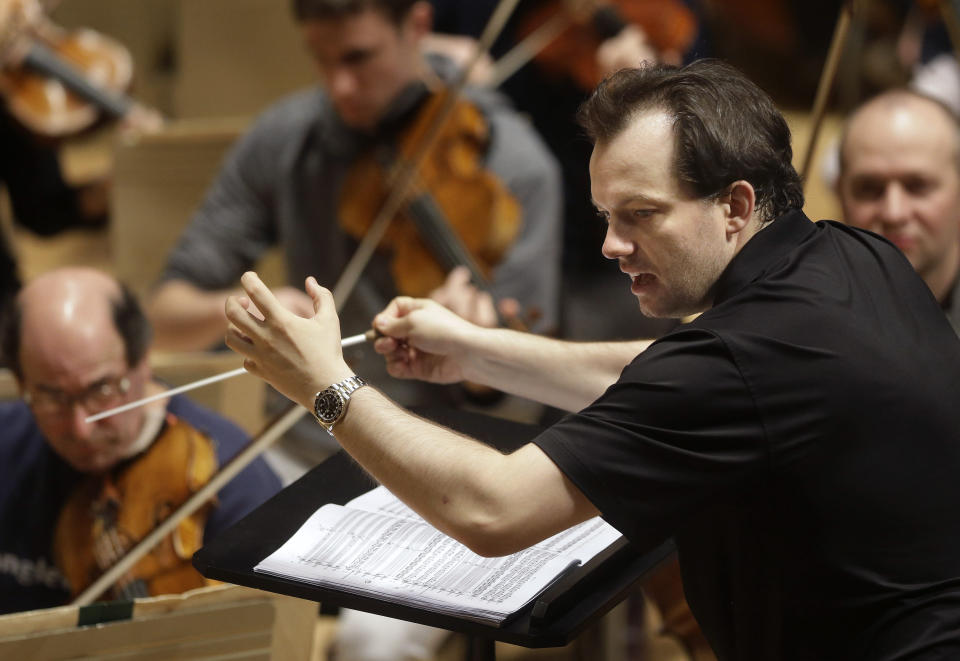 FILE- In this Nov. 20, 2014, file photo, Boston Symphony Orchestra music director Andris Nelsons rehearses at Symphony Hall in Boston. The Boston Symphony Orchestra hasn't played live for fans since the coronavirus pandemic hit a year ago, but it's returning to the stage in July for the outdoor Tanglewood festival. (AP Photo/Steven Senne, File)