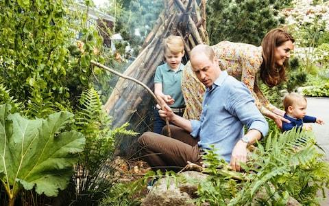 Prince William and Prince George are in charge of making the campfire - Credit: Matt Porteous