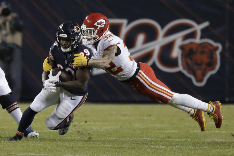 Kansas City Chiefs strong safety Tyrann Mathieu (32) tackles Chicago Bears running back Tarik Cohen (29) in the second half of an NFL football game in Chicago, Sunday, Dec. 22, 2019. (AP Photo/Nam Y. Huh)