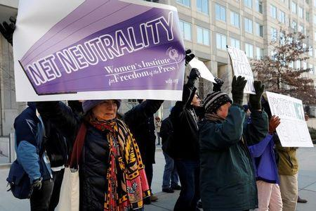 FILE PHOTO - Net neutrality advocates rally in front of the Federal Communications Commission (FCC) ahead of Thursday's expected FCC vote repealing so-called net neutrality rules in Washington, U.S., December 13, 2017. REUTERS/Yuri Gripas