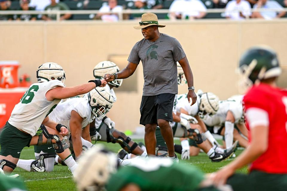 Michigan State's head coach Mel Tucker, right, fist bumps with Jacub Panasiuk during the Meet the Spartans open practice on Monday, Aug. 23, 2021, at Spartan Stadium in East Lansing.