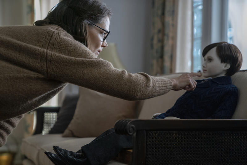 Liza (Katie Holmes) is wary of the doll in Brahms: The Boy II. (PHOTO: Golden Village Pictures)