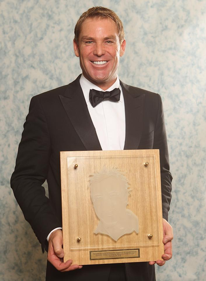 MELBOURNE, AUSTRALIA - FEBRUARY 27: Shane Warne of Australia poses with after being inducted into the Australian Cricket Hall of Fame during the 2012 Allan Border Medal Awards at Crown Palladium on February 27, 2012 in Melbourne, Australia.  (Photo by Lucas Dawson/Getty Images)