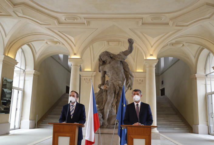 Czech Republic's Prime Minister Andrej Babis, right, and newly appointed Foreign Minister Jakub Kulhanek address media at the Cernin's Palace in Prague, Czech Republic, Wednesday, April 21, 2021. Kulhanek was appointed during a Czech Russia diplomatic crisis over the alleged involvement in a fatal ammunition depot explosion in 2014. (AP Photo/Petr David Josek)