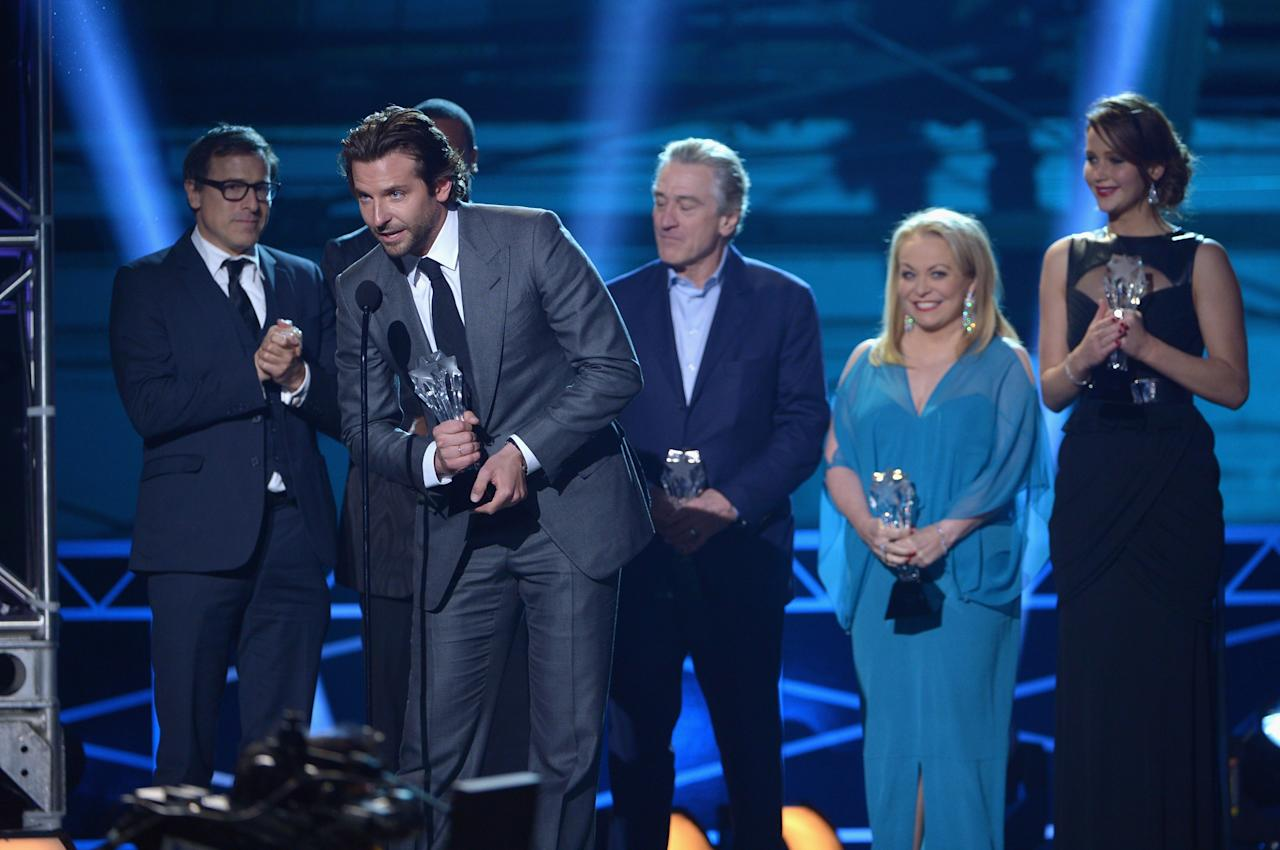 "SANTA MONICA, CA - JANUARY 10:  (L-R) Writer/Director David O. Russell, actors Bradley Cooper, Robert De Niro, Jacki Weaver and Jennifer Lawrence accept the Best Acting Ensemble Award for ""Silver Linings Playbook"" onstage at the 18th Annual Critics' Choice Movie Awards held at Barker Hangar on January 10, 2013 in Santa Monica, California.  (Photo by Kevin Winter/Getty Images)"