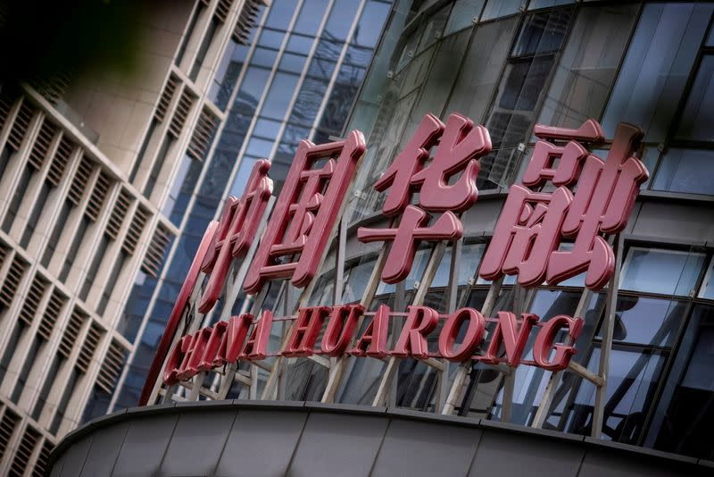 FILE PHOTO: The logo of China Huarong Asset Management Co is seen at its office in Beijing
