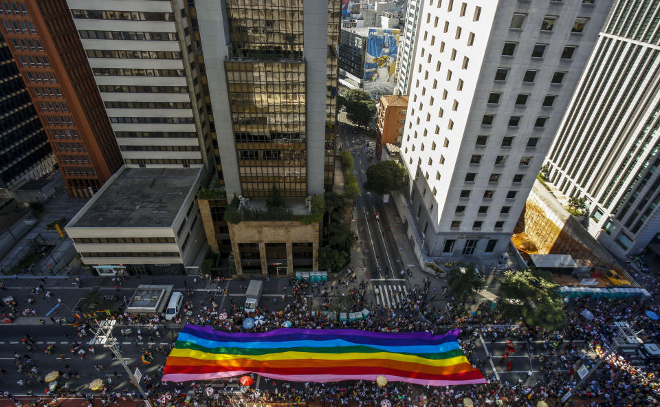 TOPSHOT - Aerial view of the 23rd Gay Pride Parade, which theme is