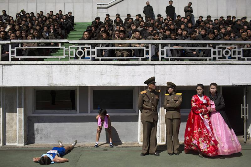 Runners rest inside Kim Il Sung Stadium in Pyongyang, North Korea on Sunday, April 14, 2013. North Korea hosted the 26th Mangyongdae Prize Marathon to mark the upcoming April 15, 2013 birthday of the late leader Kim Il Sung. (AP Photo/David Guttenfelder)