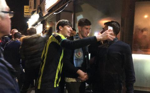 "Manchester City players made sure they enjoyed their maiden Premier League title win under Pep Guardiola in a night of joyous celebrations that began in a quiet village pub. While Guardiola was busy finishing off a round of golf with world number 12 Tommy Fleetwood, City's stars wasted no time in toasting their title triumph. Less than an hour after Manchester United's shock home defeat to West Brom confirmed arch-rivals City as champions, Guardiola's players headed to the Railway pub in Hale, near Altrincham, where the party began. Speaking to Sky Sports in the wake of Manchester United's surprise defeat, Man City defender Vincent Kompany said he was getting ready to ""go and meet the lads"". Right back Kyle Walker tweeted he was ""on his way to Benjamin Mendy's house to pick him up for the party"", while Bernardo Silva uploaded a video of himself and John Stones on their way to join their team-mates in the Hale pub. John Stones and Bernardo Silva drive to the first leg of Man City's title winning celebrations Credit: Bernardo Silva Instagram 6:30pm Kompany, who has captained for all three of Man City's Premier League title wins, got celebrations under way by delivering a victory speech to fans from the local area who had gathered to mingle with their heroes. Holding a pint of Guinness, the Belgian paid tribute to City's long-suffering fans in a speech that fans called ""Churchillian"". ""If there's kids in the room, cover their ears or send them out,"" he said. ""It's been a f***ing long journey; especially for those of you that have been a blue for more than 40 years! Kyle Walker poses for selfies with Man City fans before getting team celebrations under way Credit: Alex Hunt Twitter ""But tonight we have won it again. So let's celebrate together and have a drink!"" The group featuring Bernardo Silva, John Stones, Fabian Delph, Kyle Walker and Bernardo Silva then led chants of ""Champions!"" before handing out jagerbombs to fans. A number of well-known team songs were sang including the famous terrace chant paying tribute to Yaya Toure and his brother Kolo. 8:30pm Kyle Walker and Bernardo Silva shared snippets of their night on Instagram Credit: Kyle Walker and Bernardo Silva Instagram City players then posed for selfies with fans inside and outside the pub before heading across the road to Hale Wine Bar at 8:30pm. Portuguese playmaker Bernardo Silva paid homage to two of Man City's most famous fans, Noel and Liam Gallagher, with a rendition of Wonderwall by Oasis. pic.twitter.com/HHvJDwkejY— James Matthews (@JamesM1717) April 15, 2018 Former Tottenham right back Kyle Walker celebrated his title winning debut season at Man City by writing ""CITY"" on the condensation that had gathered on inside of the wine bar window. According to reports the celebrations inside the bar turned understandably raucous, with players swinging from lamps while singing City songs. 10:25pm Kyle Walker (left) and Bernardo Silva (right) are mobbed by City fans as they leave Hale Wine Bar Credit: PA City's victorious stars are mobbed by local fans as they attempt to leave the wine bar. Players including Kyle Walker, John Stones and Vincent Kompany stopped to take a few more pictures with supporters before leaving for an unknown destination at 10:30pm. City players out celebrating with fans tonight #MCFCpic.twitter.com/ARcEWnILkt— Andy Hampson (@andyhampson) April 15, 2018 ""We did it! An amazing journey to get here!"" Kyle Walker later tweeted. ""All the lads have done so well and it feels great to be a part of this really special group of players! Thank you for your support all season!"" The surprise nature of Manchester United's capitulation to bottom-placed West Brom meant a number of Man City's playing squad were not able to attend the celebrations. John Stones is congratulated by Man City fans Credit: John Stones PA Leroy Sane, who has been named on the shortlist for the PFA Player of the Year, was in Germany to watch his old side Schalke lose to Borussia Dortmund in the Bundesliga. Brazilian goalkeeper Ederson was also out of the country after paying a visit to his former Benfica team-mates in Lisbon. David Silva was also unable to take part in the festivities but chose to mark his third Premier League winner's medal by sharing a photo of his newborn son, Mateo, who was born extremely prematurely earlier this season. My 3rd league but this one is the most special.Thanks to everyone for supporting me in this tough year!������ pic.twitter.com/kKslE189uu— David Silva (@21LVA) April 15, 2018 With City players inevitably nursing a number of sore heads this morning, Pep Guardiola has given his squad today and tomorrow off as reward for their achievement. The Catalan, who shared a picture from his round of golf with English golfer Tommy Fleetwood, tweeted: ""Thank you Man City. Thanks to the fans for their unconditional support. And thanks to the squad and coaching staff, who've made this Premier League title run a fantastic experience!"""