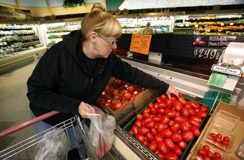 Elaine Deal, of Des Moines, Iowa, shops for tomatoes at a local Dahl's grocery store, Wednesday, March 23, 2011, in Des Moines, Iowa. The sharpest increase in produce prices in decades should ease in coming weeks as growers deliver more tomatoes, lettuce and other crops to grocers. (AP Photo/Charlie Neibergall)