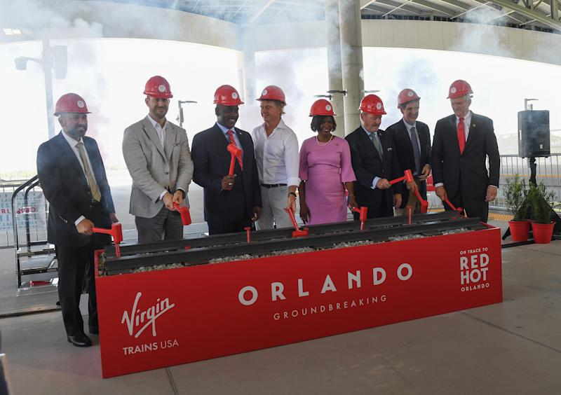 Local dignitaries and Virgin Atlantic USA representatives Domingo Sanchez, chairman, Greater Orlando Aviation Authority; Patrick Goddard, president of Virgin Trains USA; Jerry Demings, Mayor of Orange County; Wes Edens, chairman of Virgin Trains; Congresswoman Val Demings; Buddy Dyer, Mayor of Orange County; Quintin Kendall, FRA deputy administrator; and Congressman Dan Webster, celebrate Virgin Trains USA's official groundbreaking of their expansion into Orlando on Monday, June 24, 2019, at the Orlando International Airport.