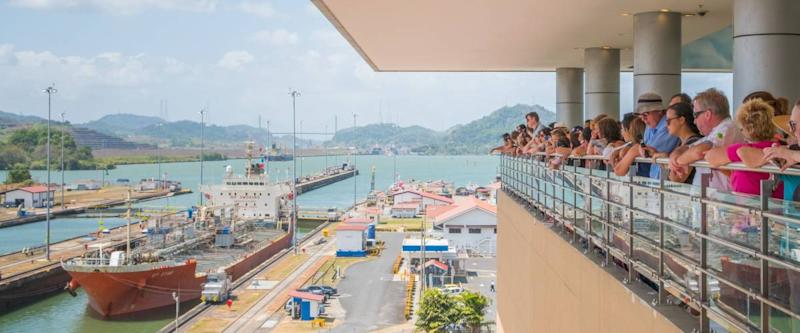 Panama City, Panama - march 2018: Group of tourist people at viepoint balustrade looking at Panama Canal, Miraflores Locks, Panama City