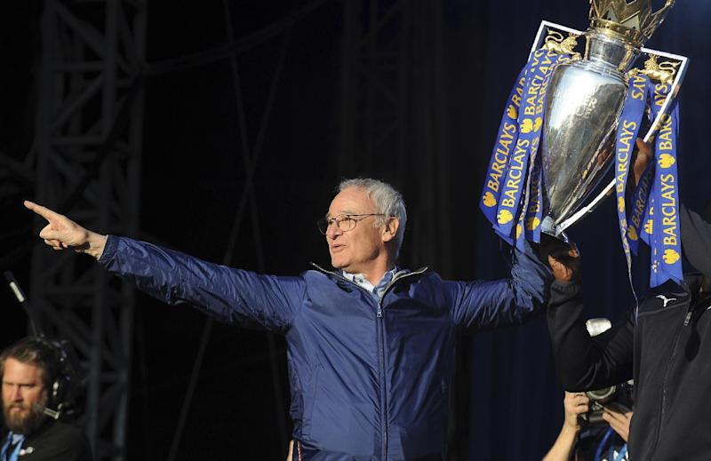 FILE - In this Monday, May 16, 2016 file photo, Leicester's manager Claudio Ranieri shows the Premier League Trophy to fans at Victoria Park during the victory parade to celebrate winning the English Premier league title in Leicester, England. Leicester City announced Thursday, Feb. 23, 2017 that they have sacked manager Claudio Ranieri less than a year after their incredible run to the Premier League title. (AP Photo/Rui Vieira, File)