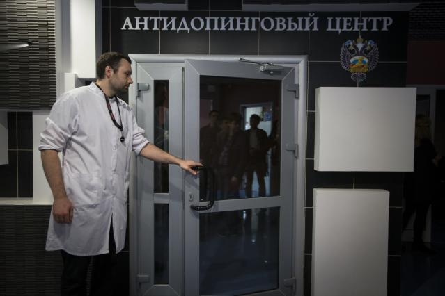 FILE - In this Tuesday, May 24, 2016 file photo, Grigory Dudko opens a door for journalists during a visit to Russia's national drug-testing laboratory in Moscow, Russia. Russia is accused of manipulating an archive of doping data from a laboratory in Moscow, which was meant to be a peace offering to the World Anti-Doping Agency to solve earlier disputes. (AP Photo/Alexander Zemlianichenko, File)