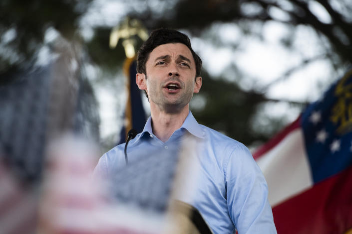 Jon Ossoff, Democratic candidate for U.S. senate, speaks during a drive-in rally in Columbus, Ga. (Tom Williams/CQ-Roll Call Inc. via Getty Images)